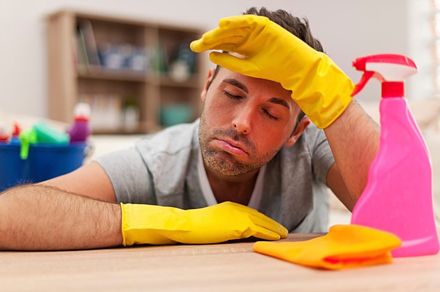 exhausted man wearing rubber gloves